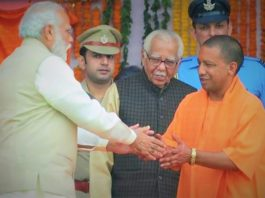 modi with yogi in hindi